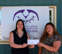 SN Development Corp makes donation to food bank